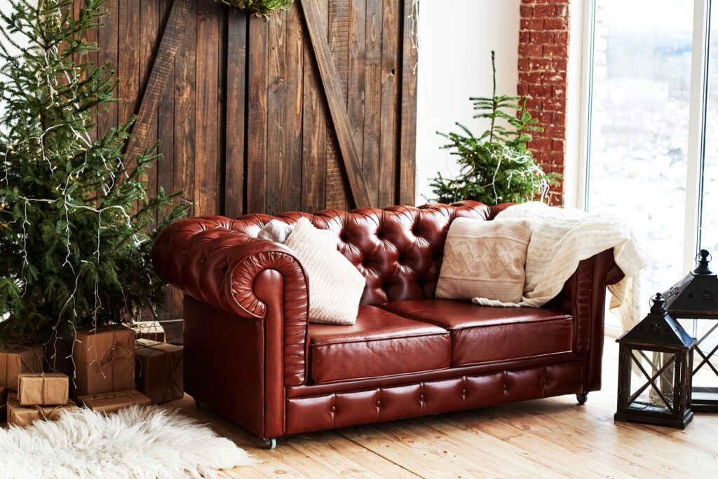 Vintage Brown Leather Chesterfield Sofa in Loft Living Room with Christmas Tree