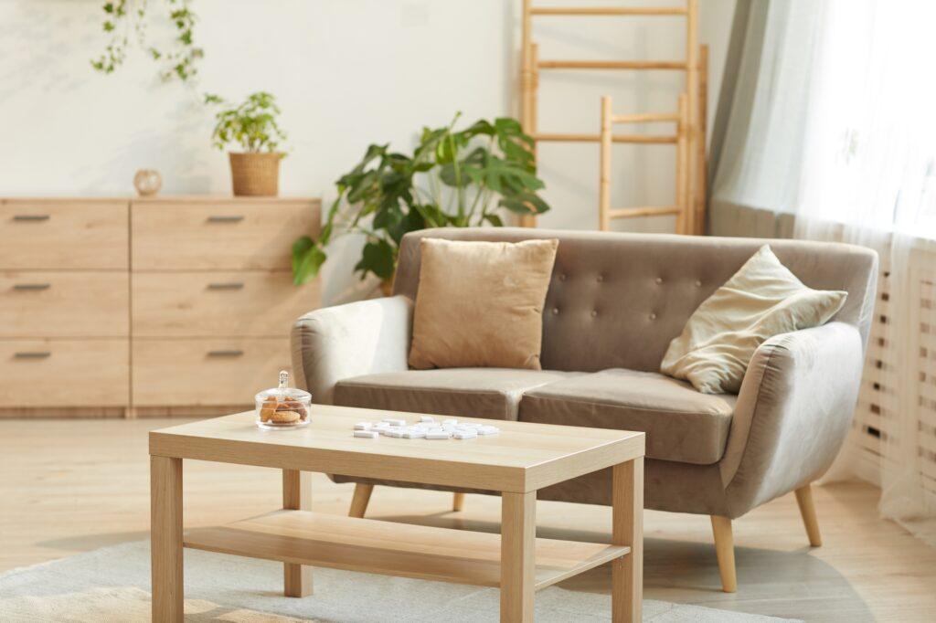 Warm Modern Boho Den with Deep Beige Sofa and Handcrafted Furnishings