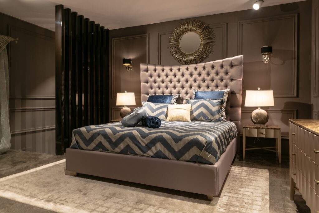 Brown Luxury Bedroom with Carved Wood Bed and Nightstands