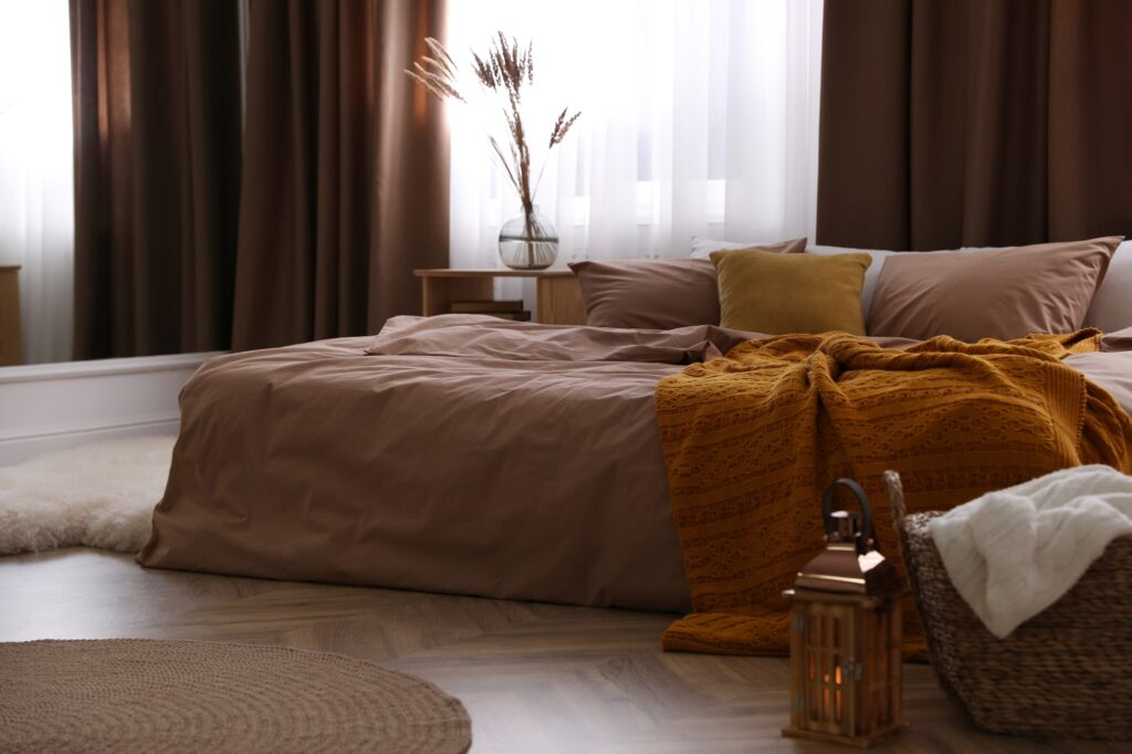 Brown Themed Bedroom with Large Modern Bed and Natural Light