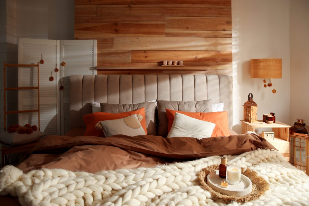 Colorful Arts and Crafts Style Bedroom in Warm Brown Tones
