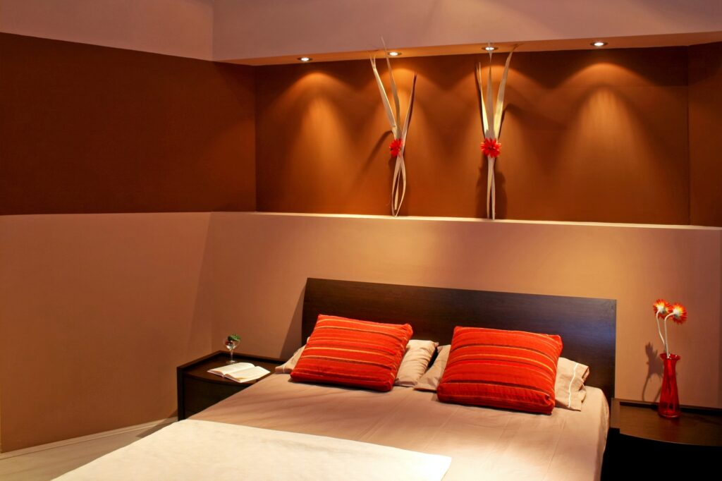 Contemporary Brown Minimalist Mode Bedroom with Red Pillows