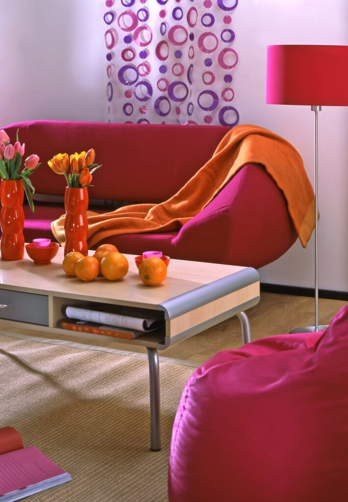 Contemporary Den with Rose Red Sofa and Natural Fiber Rug
