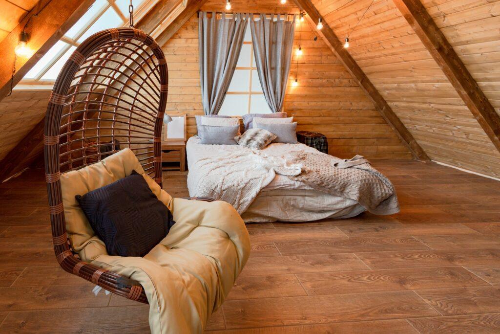 Cozy Boho Style Garret Bedroom with Rustic Wood Walls and Floor