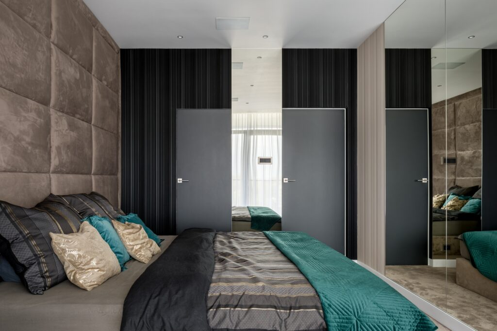 Elegant Upscale Bedroom with Mirrored and Upholstered Walls