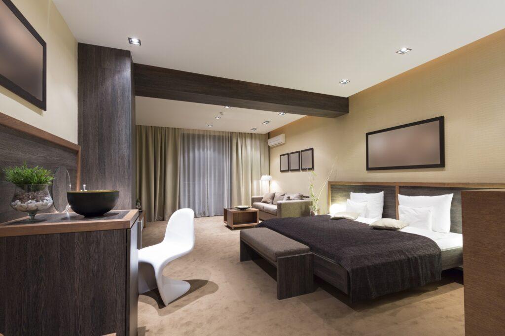 Large Contemporary Bedroom Interior in Elegant Brown Tones