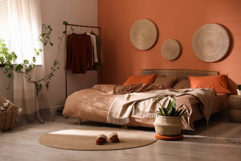 Low Bed in Rustic Brown Toned Bedroom with Simple Decor