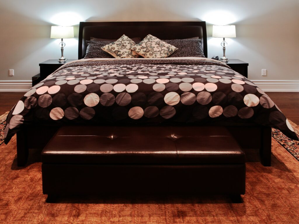 Luxurious Bedroom with Elegant Bed and Chest in Rich Brown Leather