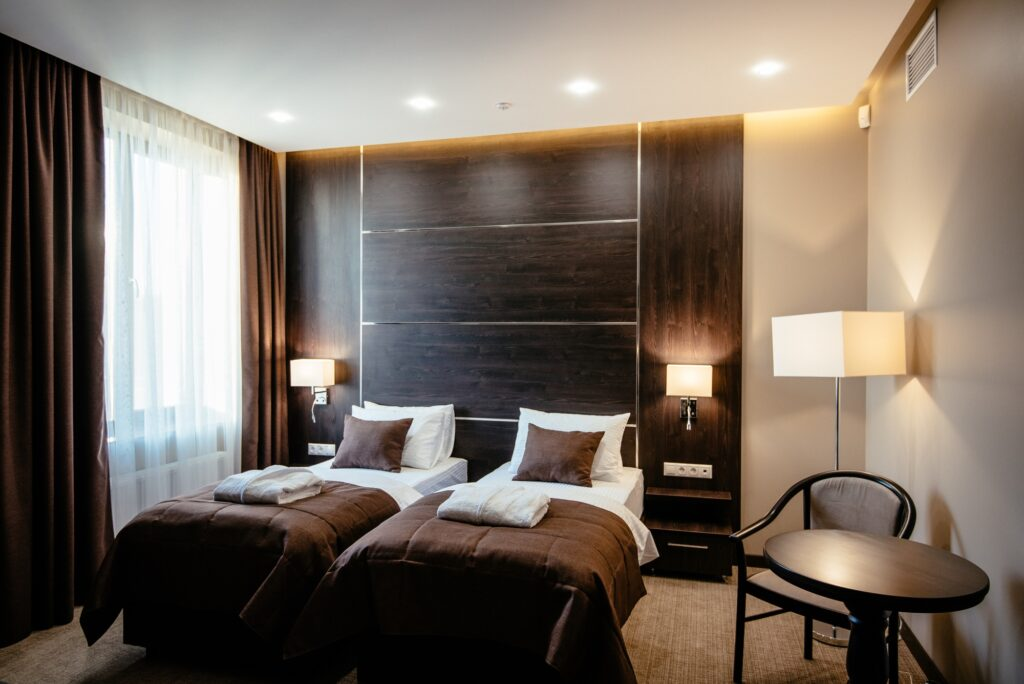Modern Brown Bedroom with Charming Twin Beds and Soft Sunlight