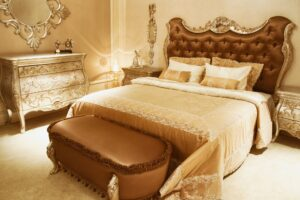 Ornate Brown Shabby Chic Bedroom with Elaborate Gold Details