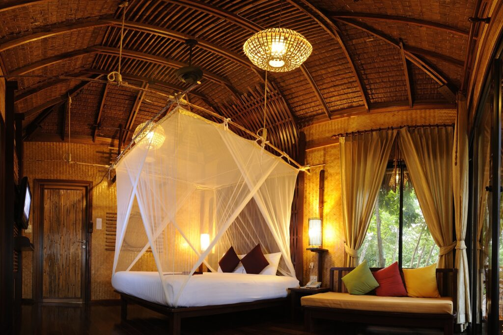 Tropical Asian Style Brown Bedroom with Vaulted Wood Ceiling