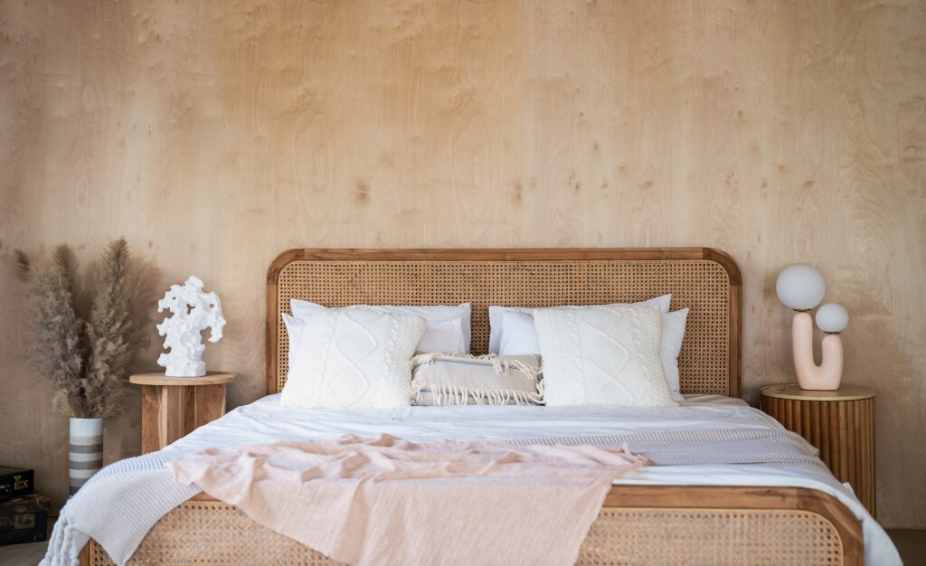 Warm Brown Bedroom Interior with Rustic Wall and Bed