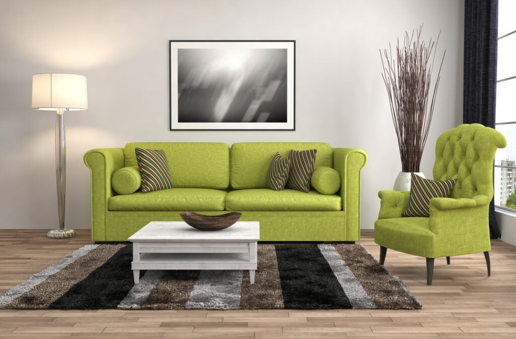 Elegant Chartreuse Sofa and Tufted Wing Back Chair with Creative Rug
