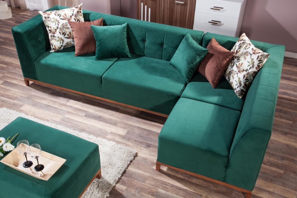Forest Green Corner Sofa with Soft Beige Nubby Weave Rug