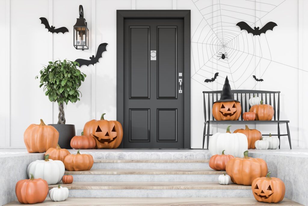 Front Steps of Home with Clusters of Carved Pumpkins for Halloween