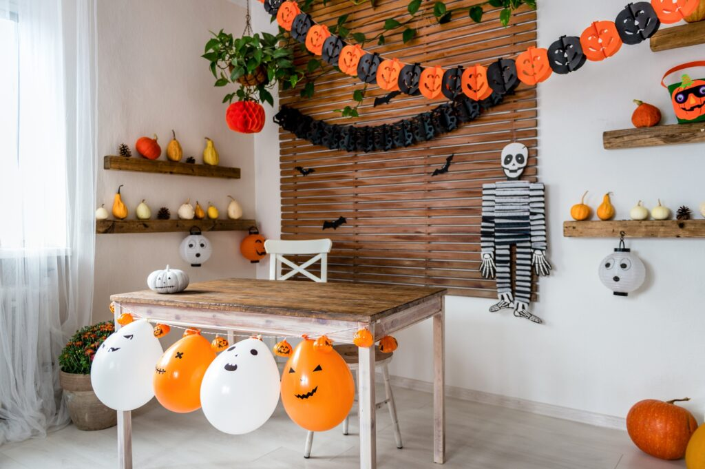 Halloween Living Room Display with Pumpkins, Gourds, Balloons and Skeleton