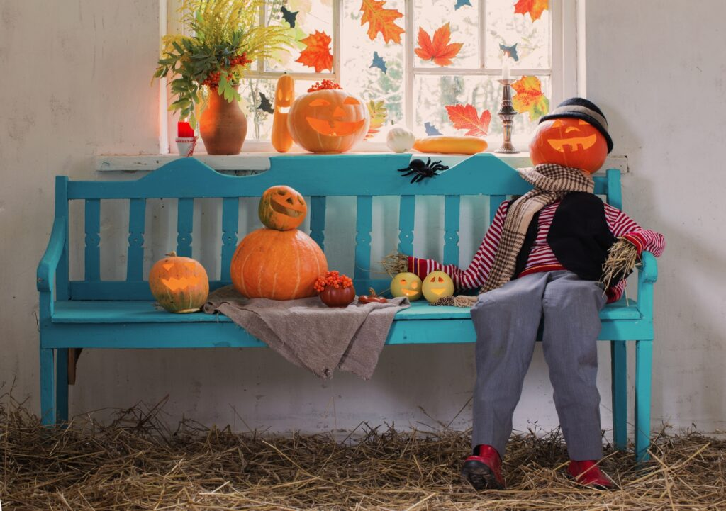 Humorous Halloween Bench Display with Pumpkin Headed Life Size Doll