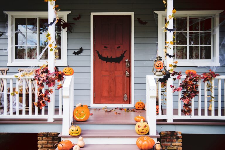 Porch with Funny and Fierce Halloween Jack o' Lanterns and Autumn Leaves
