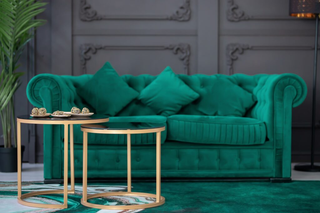 Regal Green Sofa Against Deep Gray Wall with Matching Green Carpet