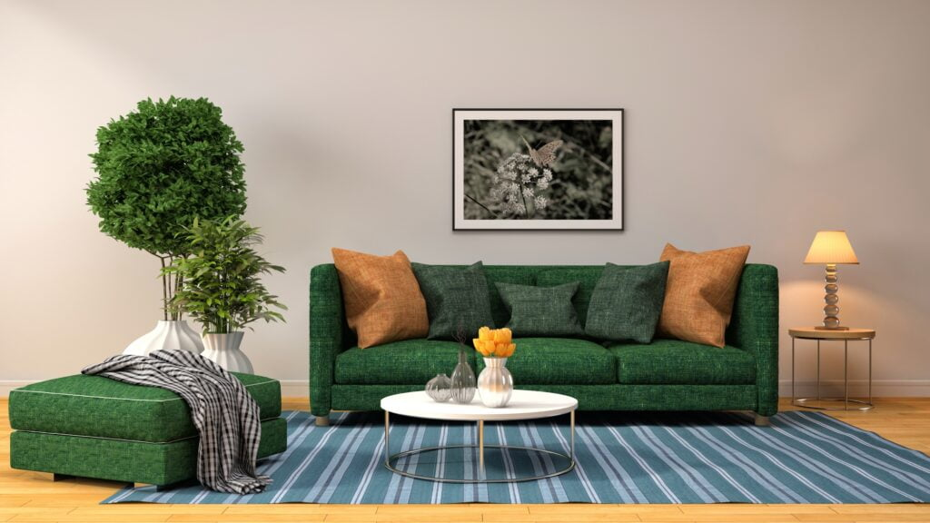 Simplistic Den Design with Forest Green Sofa and Striped Rug