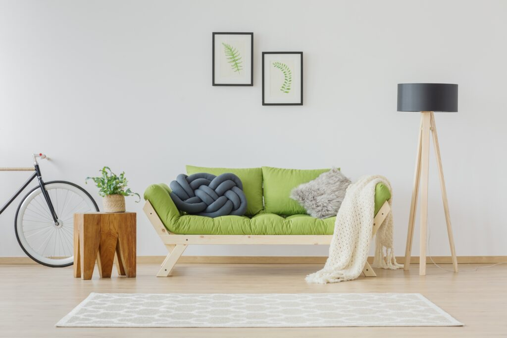 Stylish Contemporary Futon Sofa in Spring Green with Gray Patterned Rug