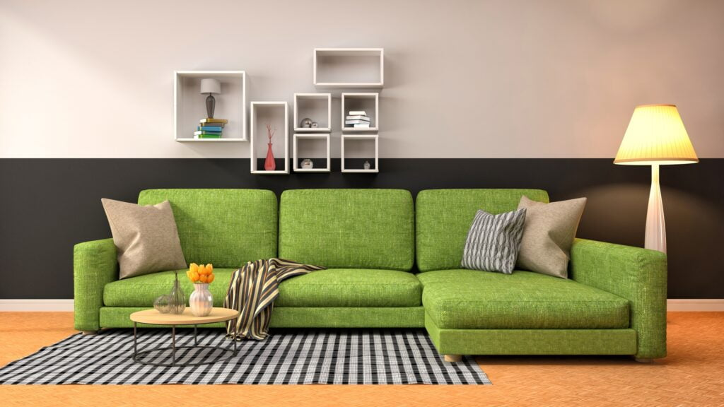 Warm Green Textured Sofa with Black and Gray Checked Rug