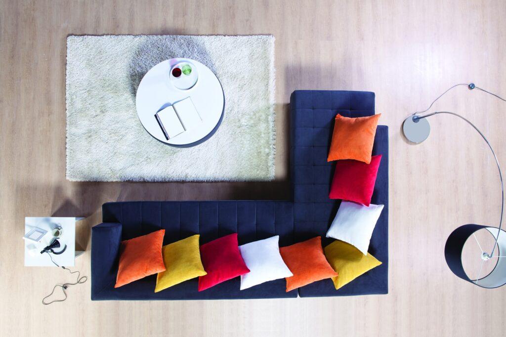 Orange Pillows on Corner Sofa