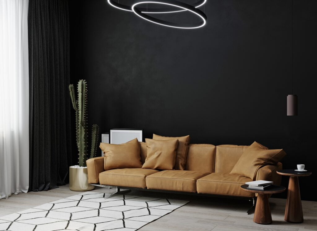 Black Wall With Brown Sofa